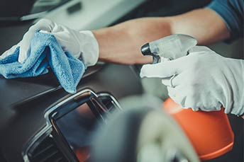 Car dashboard being sanitized